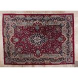 A Kashan rug, IranIn Wool and cotton Floral design in shades of beige, burgundy, green and blue