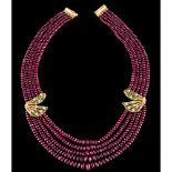 A five strand ruby beads necklaceGold clasp and applied elements Green enamel decoration and set