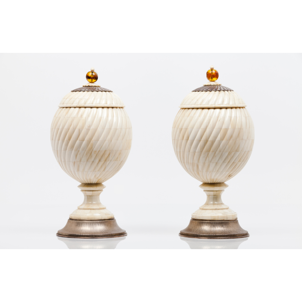 A pair of pots with coversWooden carcass coated in ivory with amber lid pommels Spiralled decoration