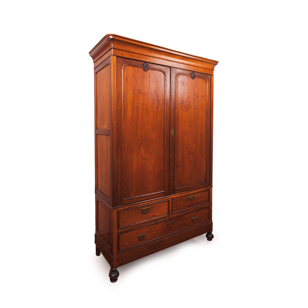 A Romantic Era wardrobeSolid and veneered mahogany Two doors, two drawers and one long drawer
