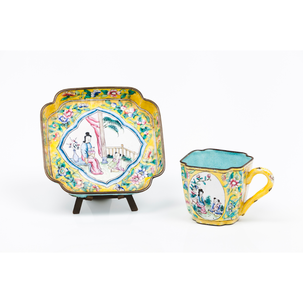 A cup and saucerEnamel on copper Polychrome decoration Frames with Chinese daily scenes and floral