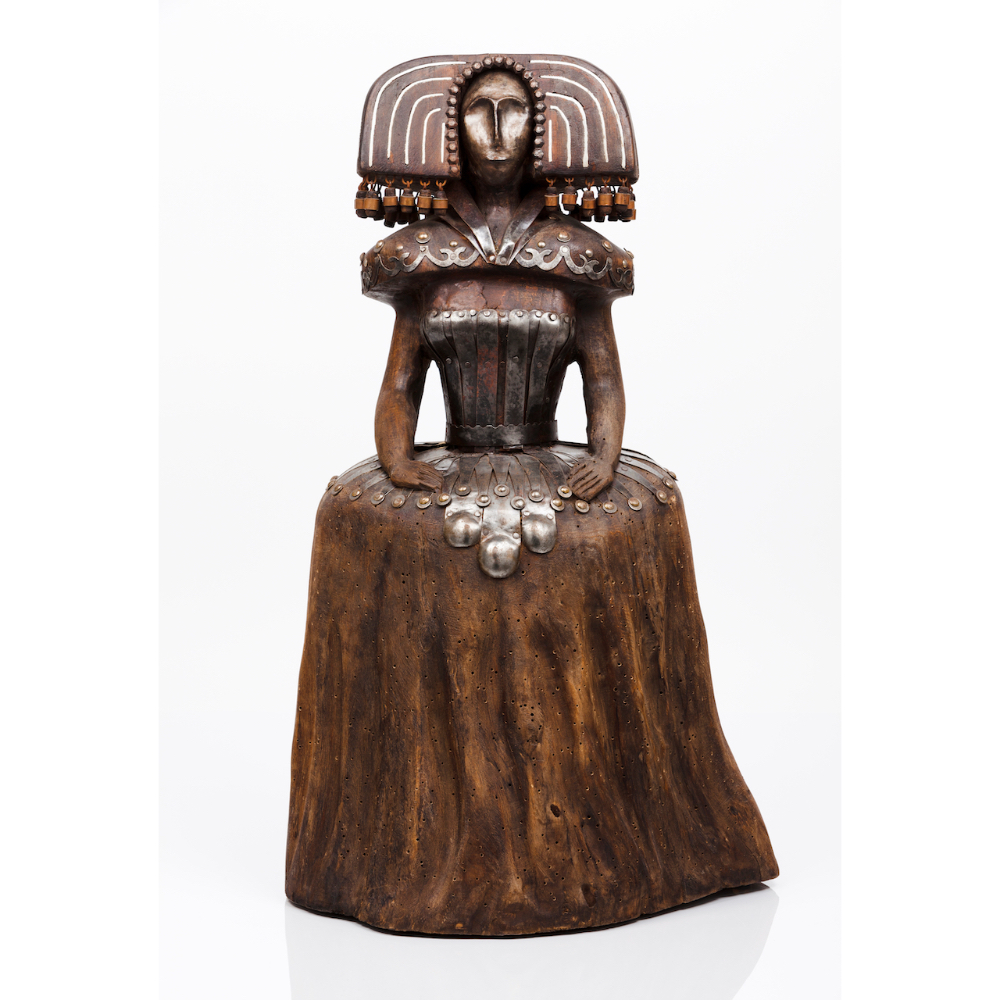 A 17th century ladyCarved wooden sculpture of metal inlaid decoration 20th century (evidence of