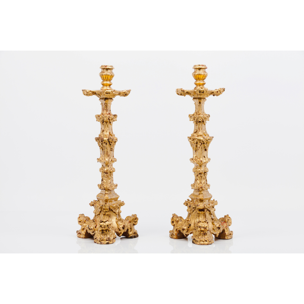 A pair of large D.José candle standsCarved and gilt wood Portugal, 18th century (minor losses and