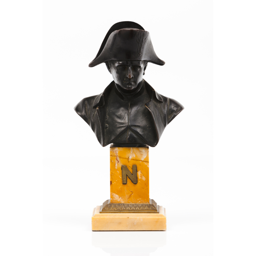 """A bust of NapoleonPatinated bronze sculpture Marble stand with frieze and yellow metal """"N"""" Signed """""""