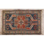 A rugIn wool and cotton Geometric design in shades of burgundy and beige291x190cm