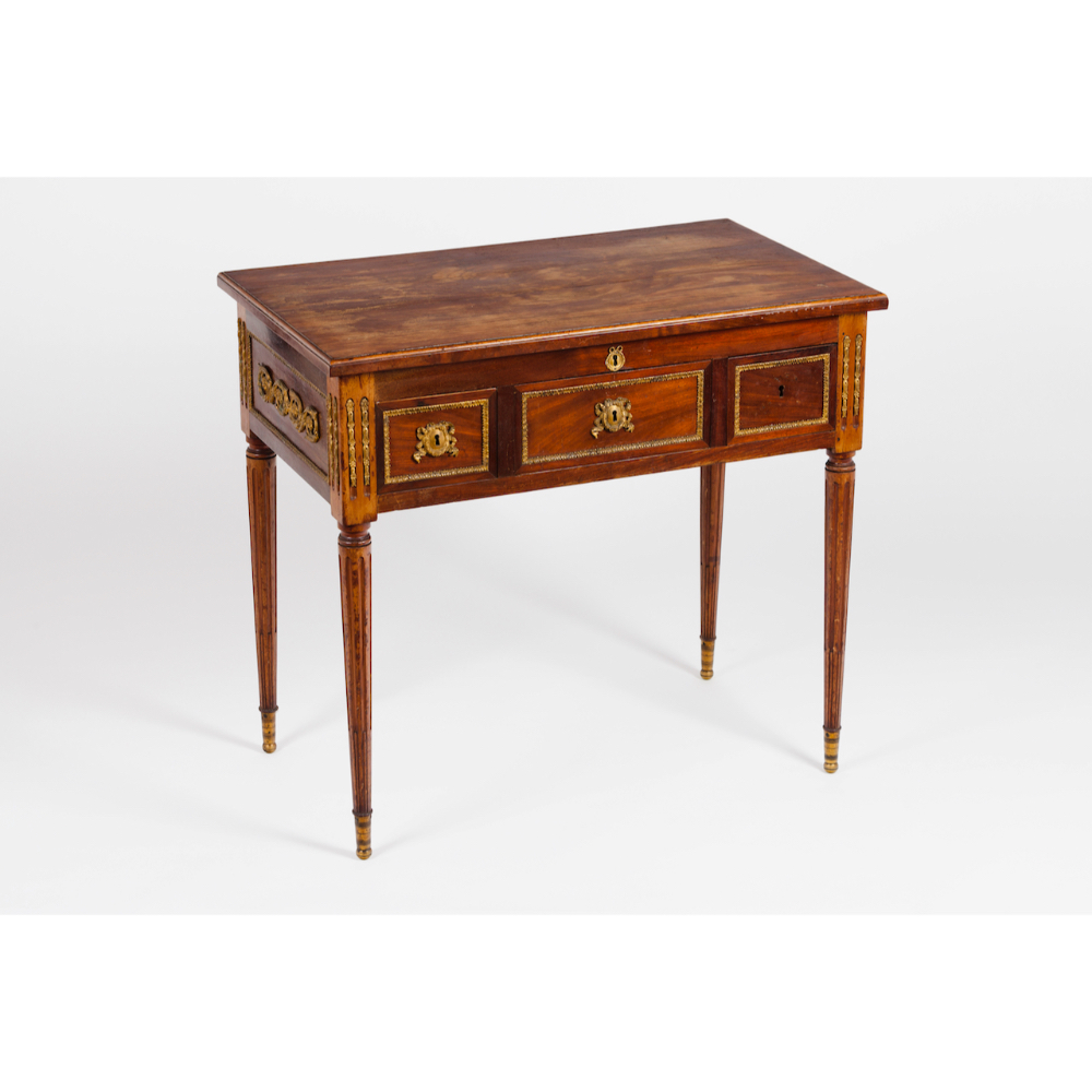 A Louis XVI style dressing tableIn cherry wood and other timbers Bronze hardware Inner marble top