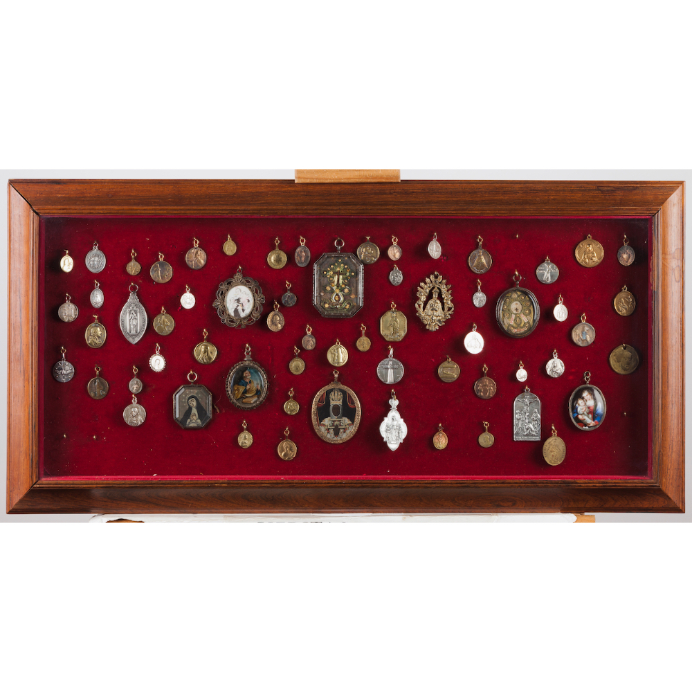 A suspending display cabinet with collection of various medalsInterior with religious medals
