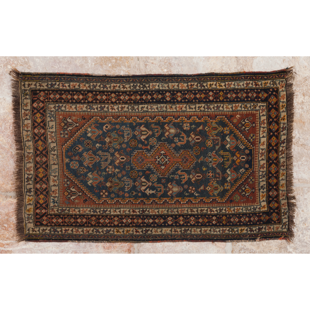 A kashal rug, IranIn wood and cotton Geometric design in shades of burgundy, green and blue (signs