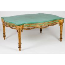 A large Neoclassical centre tableWood Gilt, carved and marbled decoration Scalloped top in green