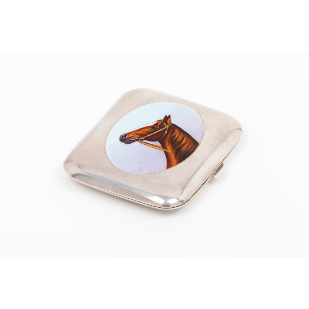 A cigarette caseEuropean silver Plain body of enamelled decoration with horse's head Stamped 900/