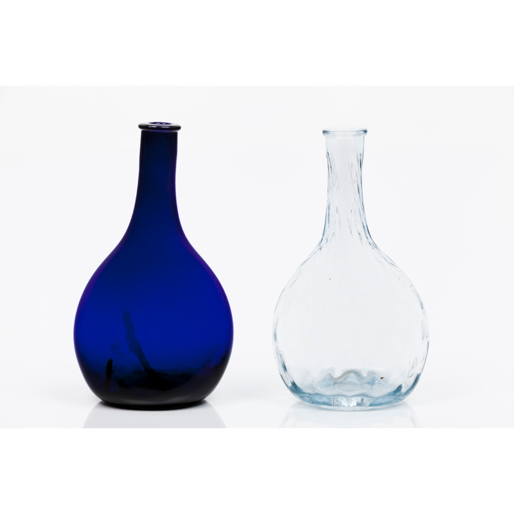 A group of two bottlesMoulded blue and translucent glass Europe, 19th centuryHeight: 17 cm