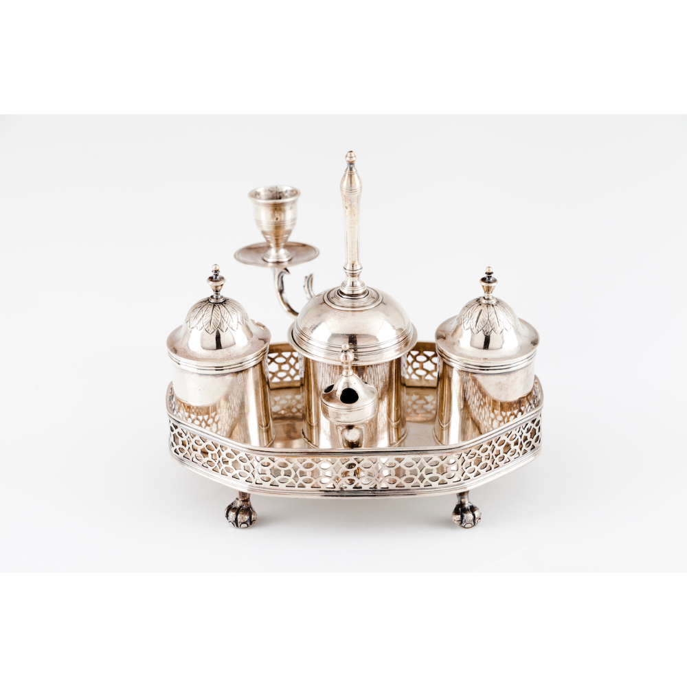 An inkwellPortuguese silver, 18th/19th century Galleried hexagonal shaped with bell and candle stick