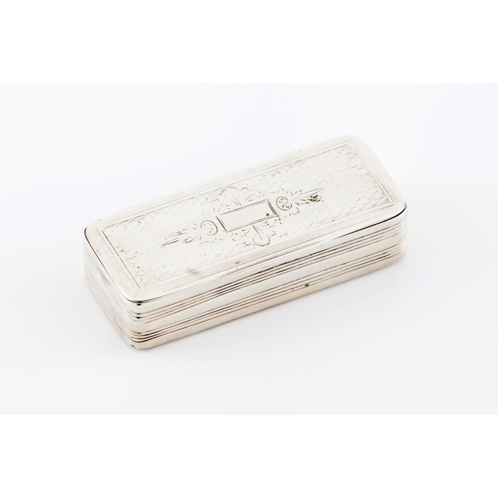 A snuff boxSilver, 19th century Striated and engraved decoration Unmarked in compliance with