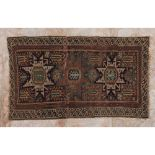 A shirwan rug, Russian wood and cotton Geometric design in shades of burgundy, green and blue (signs