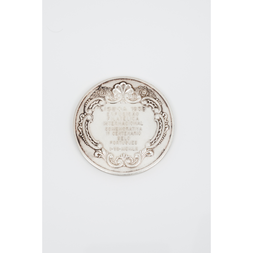 A commemorative medal for the first centennial of the Portuguese stampSilvered metal Queen Maria