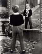 """Alfred Eisenstaedt. """"Young English man looking in the mirror of the Grand Hotel in St. Moritz"""". 1932"""