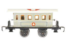 Märklin Sanitätswagen 1828 K, S 0, HL, mit Kücheneinrichtung und 4 AT, Rahmenbereich tw