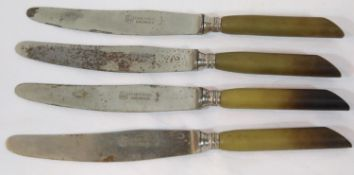 Four German WWII type Waffen SS Horn Handle Dinner Knives. P&P Group 2 (£18+VAT for the first lot