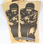 Twenty unused paper rifle targets, and a Parachute Regiment shoulder title. P&P Group 1 (£14+VAT for