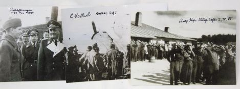 Four photographic stills of POW camps, each bearing a signature of a POW, no COA. P&P Group 1 (£14+
