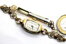 Ladies 9ct gold cased Rotary wristwatch on an unmarked yellow metal bracelet. P&P Group 1 (£14+VAT