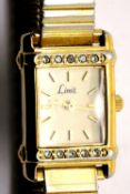 Ladies Limit gold plated stainless steel rectangular wristwatch on expandable bracelet with new