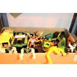 Box of mixed toys and figurines including Benio. Not available for in-house P&P