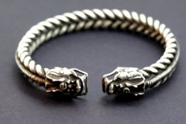 White metal Tibetan silver twisted rope effect bangle with dragon head decoration. 38g. P&P Group 1
