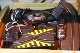 Slot car track with two cars and controllers. Not available for in-house P&P