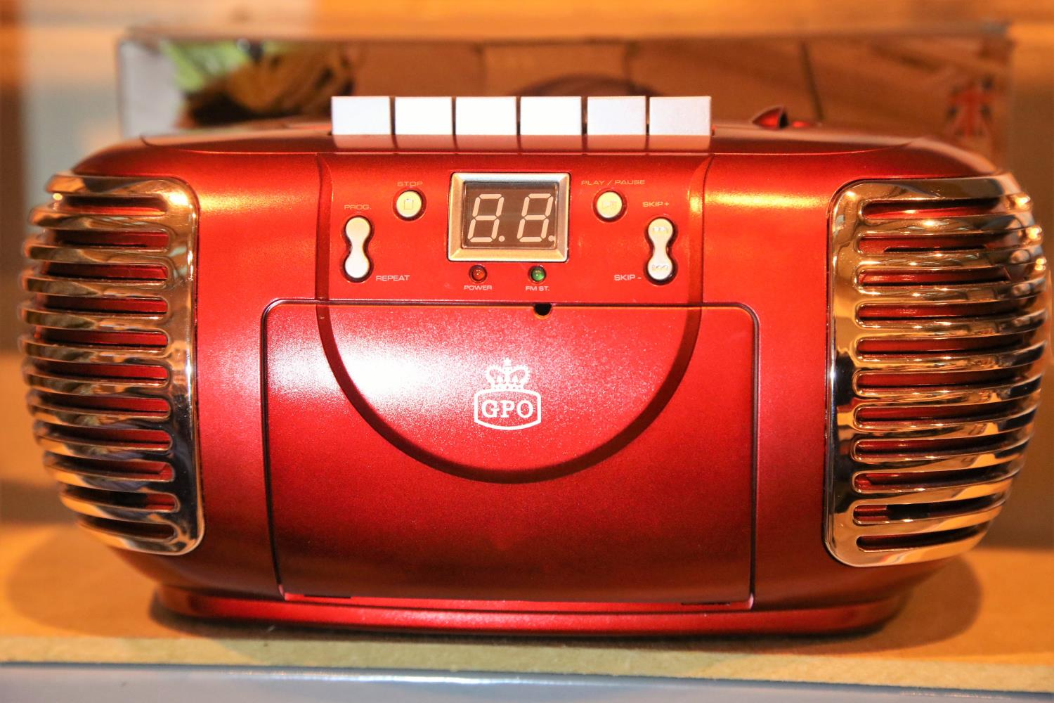 Red 3-in-1 FM/AM radio, CD and cassette player, boxed GPO PCD299. Not available for in-house P&P