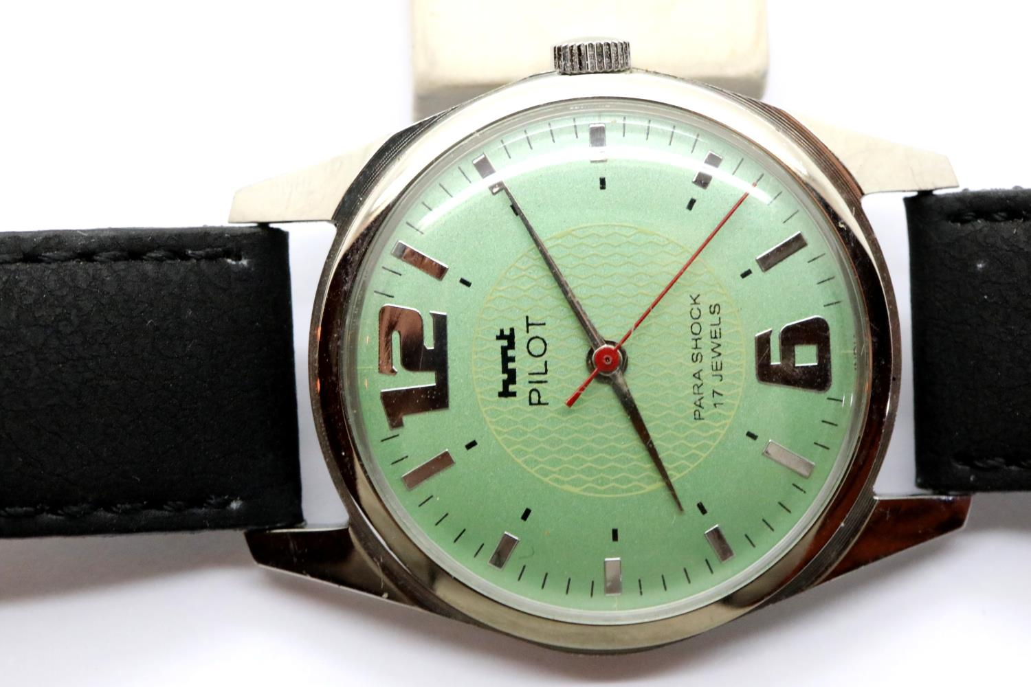 Vintage type HMT pilot mechanical wristwatch with sage green dial and black leather strap. Not