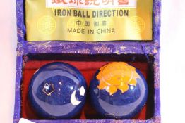 Pair of oriental iron directional balls. Not available for in-house P&P