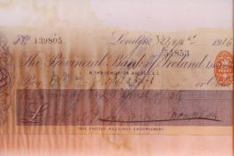 Framed and glazed Provincial Bank of Ireland cheque, dated 1916. Not available for in-house P&P