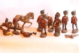 Tray of mixed metal and plastic vintage figurines. Not available for in-house P&P