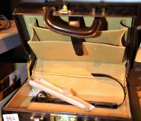 Leatherette suitcase type jewellery box, with broken handle. Not available for in-house P&P
