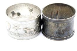 Indian silver relief decorated circular napkin ring, marked 75S, and a hallmarked silver napkin