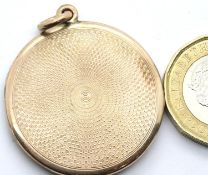 Presumed 9ct gold circular locket with machine turned decoration, unmarked, D: 31 mm, 10.7g. P&P