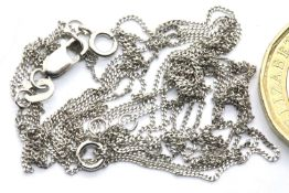 Three 9ct white gold neck chains, tangled, combined 2.7g. P&P Group 1 (£14+VAT for the first lot and
