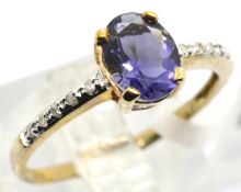 9ct gold tanzanite ring with diamond shoulders, size O, 1.7g. Condition report: Surface scratching