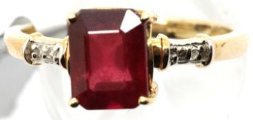 9ct gold emerald cut ruby ring with diamond shoulders, size S/T, 3.1g. P&P Group 1 (£14+VAT for
