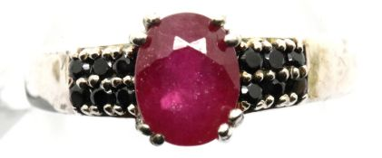 Sterling silver ruby ring with stone set shoulders. Size O, 3.2g. P&P Group 1 (£14+VAT for the first