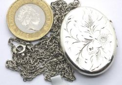 Hallmarked silver engraved oval locket, L: 35 mm and a Prince of Wales chain, L: 60 cm. (Hallmarks