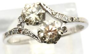 Vintage 1920s 18ct white gold diamond engagement ring, the crossover set champagne coloured stones