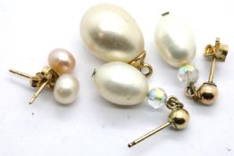 Two pairs of pearl mounted presumed gold studs and a yellow metal mounted pearl pendant. P&P Group 1
