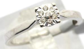 Ladies 9ct white gold diamond cluster ring, size K, 2.2g. P&P Group 1 (£14+VAT for the first lot and