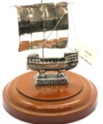 Sterling silver ship of Kyrenia, mounted on a turned plinth, H: 10 cm. P&P Group 1 (£14+VAT for
