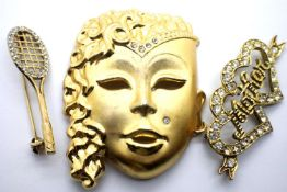Three presumed 925 silver and gilt brooches; Face, Tennis, and Mother. Total weight 20.5g. P&P Group