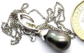 Contemporary Baroque pearl and stone set silver pendant on a silver chain. Pendant L: 2 cm, chain L: