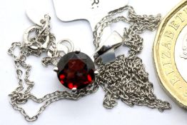 Sterling silver Cuamba garnet pendant necklace, with certificate, chain L: 63 cm. P&P Group 1 (£14+