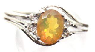 Sterling silver ring set with an Ethiopian opal and diamonds. Size S, 3.5g. P&P Group 1 (£14+VAT for